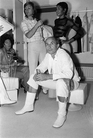 26 Jul 1972, Paris, France --- Fashion designer Courreges sitting in his studio in Paris with models during a fitting. --- Image by © Condé Nast Archive/Corbis