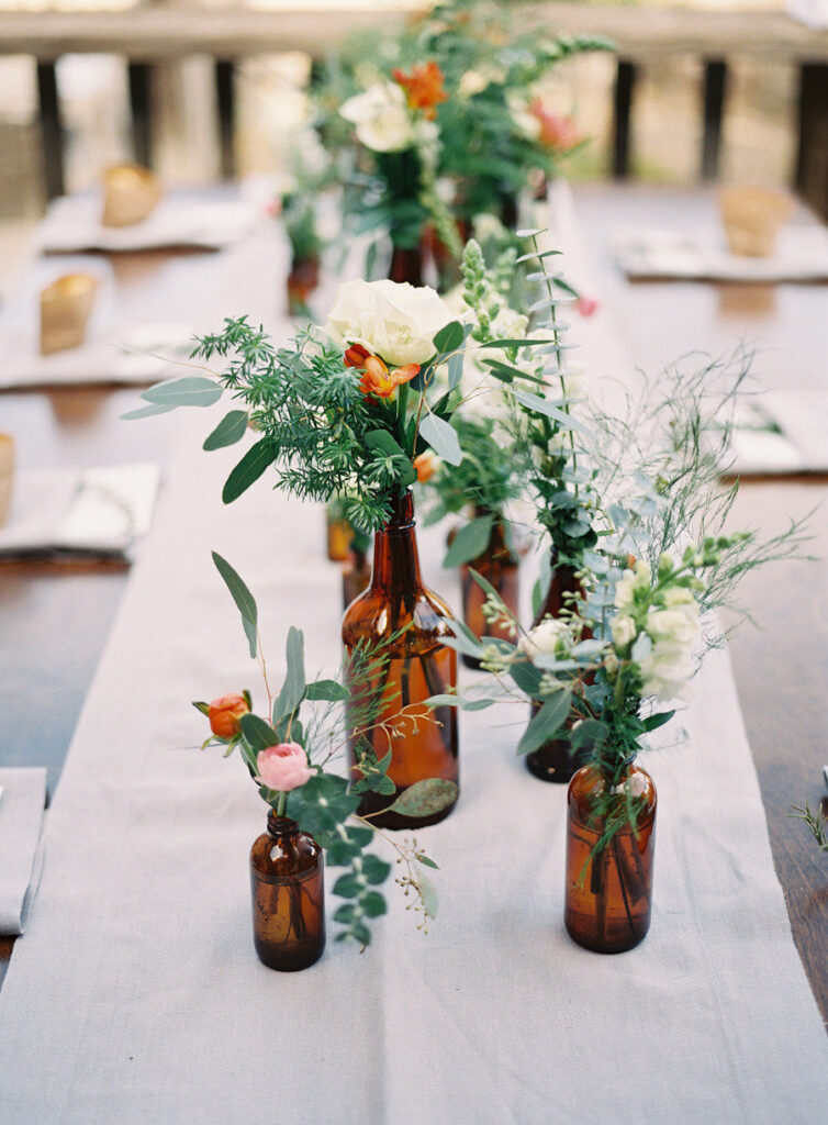 long-wedding-table-featuring-wine-bottles-like-centerpieces