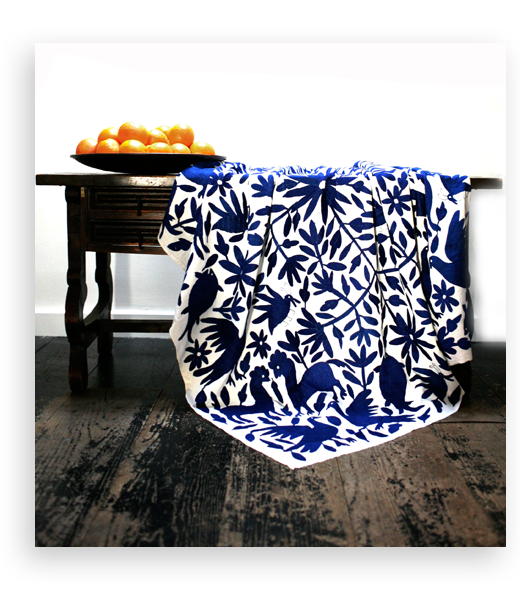 mexican_coverlet_indigo_on_table_product-slide
